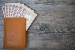 Thailand passport and pile of Thai bath money & x28;passport& x29; Stock Photo