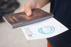 Thailand passport and postcard. In hand women royalty free stock photography