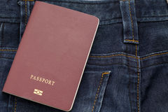 Thailand passport puting on blue jean pants,this image for fashion. And travel stock photo