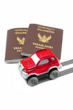 Thailand passport and red 4wd car for travel concept Royalty Free Stock Images