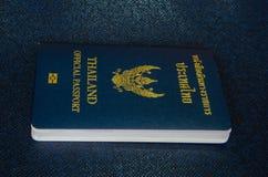 Thailand passport. Single thailand passport on dark blue background stock photography