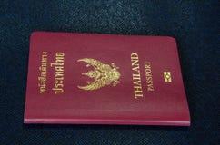 Thailand passport. Single thailand passport on dark blue background royalty free stock photography