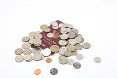 Thailand passport and Thai baht coin money. Thailand passport and Thai baht coin money on white background royalty free stock photo