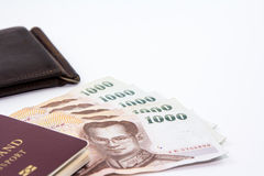 Thailand passport and Thai maney And old wallet. Thailand passport and Thai money and old wallet on white background royalty free stock images