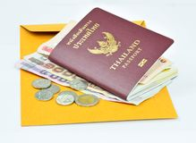 Thailand passport and Thai mone Stock Photos