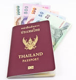 Thailand Passport and Thai money Royalty Free Stock Photo