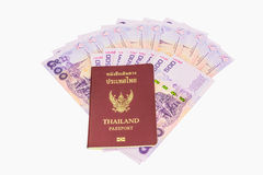 Thailand passport and Thai money. Concept of traveling. Royalty Free Stock Photo