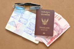 Thailand passport and Thai money Royalty Free Stock Photography