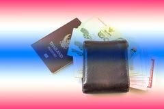 Thailand passport and Thai money Royalty Free Stock Photos