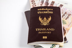Thailand passport with Thai money and free left space Royalty Free Stock Photos