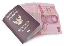 Thailand passport and Thai money Royalty Free Stock Photo
