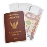 Thailand passport and Thai money Stock Photo