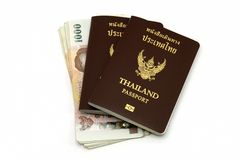 Thailand passport and Thai money. Isolated on white background stock photography