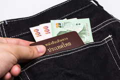 Thailand passport with Thai money Royalty Free Stock Photos