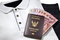 Thailand passport. And thai money,Placed on the clothes and travel stock photos