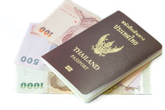 Thailand passport with Thai money. Ready to travel isolated on white background Stock Images
