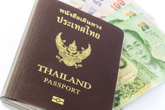 Thailand passport with Thai money Stock Photo