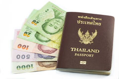 Thailand passport with Thai money. Ready to travel isolated on white background Stock Photos