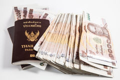 Thailand passport with Thai money Royalty Free Stock Photography