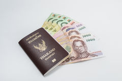 Thailand passport with Thai money ready to travel Stock Images