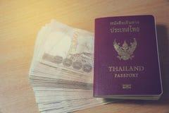 Thailand passport and Thai money savings Stock Photography