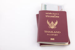 Thailand passport and Thai money for travel Stock Images