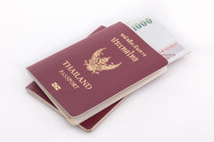 Thailand passport and Thai money for travel Royalty Free Stock Photos