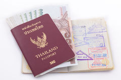 Thailand passport and Thai money for travel Stock Photos