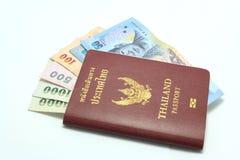 Thailand Passport With Thai Money Stock Photos