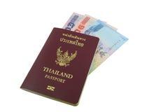 Thailand passport with Thai money. On white background royalty free stock image