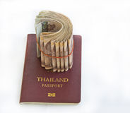 Thailand passport and Thai money on white Royalty Free Stock Photography