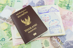Thailand Passport on Thailand Banknotes Stock Photos