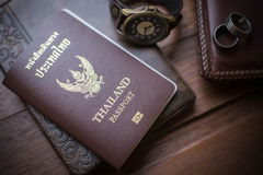 Thailand passport and traveler set on wood background, vintage a. Nd retro style royalty free stock image