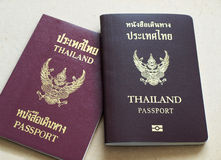 Thailand passport. Two different Thailand passports, new passport is above old passport royalty free stock images