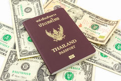 Thailand passport on U.S. Currency bank note. Royalty Free Stock Images