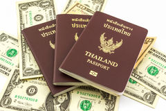 Thailand passport on U.S. Currency bank note. Royalty Free Stock Image