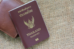 Thailand passport with Wallet on sack background. Thailand passport on sack background royalty free stock photo