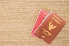 Thailand Passport on wood background. Travel around the world stock photos
