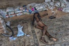 Homeless lies on the sidewalk Royalty Free Stock Photo