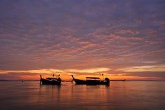 Thailand. Phi Phi island. Magic sunrise landscape. With thai boats and colorful sky stock photo