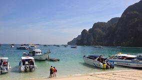 Thailand, Phi Phi Islands, Speedboats at Anchor and Unidentified Tourists. stock video