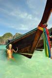 Thailand. Phi Phi Leh island. Girl at Maya bay. Thailand. Andaman sea. Ko Phi Phi Leh island. Maya bay. Colorful tropical landscape and a smiling girl in orange Stock Photos