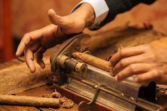 To make a cigar with his hands, sheets for a cigar, handwork.  Stock Photo