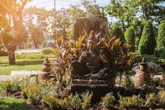 Thailand, Phuket. Buddha statue located on the street, surrounded by greenery. The concept of religion. The concept of tourism royalty free stock images