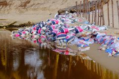 Thailand. Phuket - 08/05/18. Dirty brown water with garbage in canal stock photo