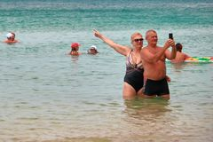 THAILAND, PHUKET, MARCH 23, 2018 - Elderly couple, man and woman take selfie against the tropical sea. Copy space. stock image
