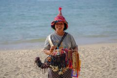 05/05/2018. Thailand. Phuket. Portrait of a old woman of Asian appearance standing on the edge of the sea and selling handmade stock photo