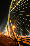 Thailand Rama 8 rope bridge night scape. Side the river Stock Photo