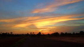 Thailand rural road sunset evening in golden sky Stock Images
