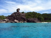 Thailand's Similan Islands. Showing rocks, blue water and sandy beach Royalty Free Stock Images